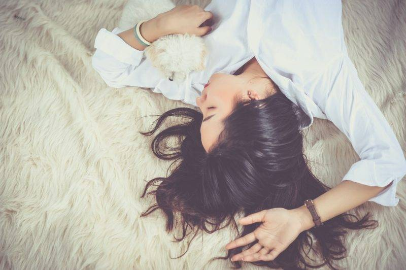 Woman Sleeping On Floor