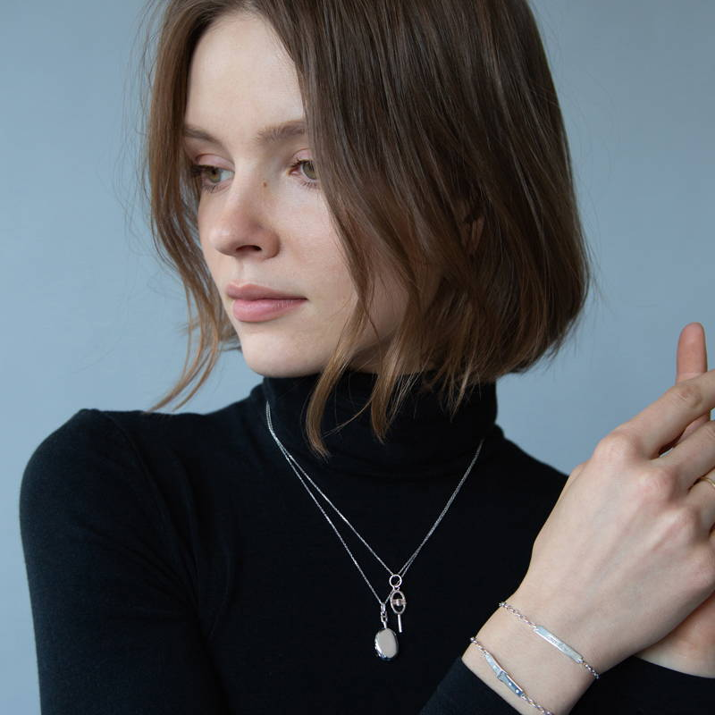 Woman wearing sterling silver necklaces