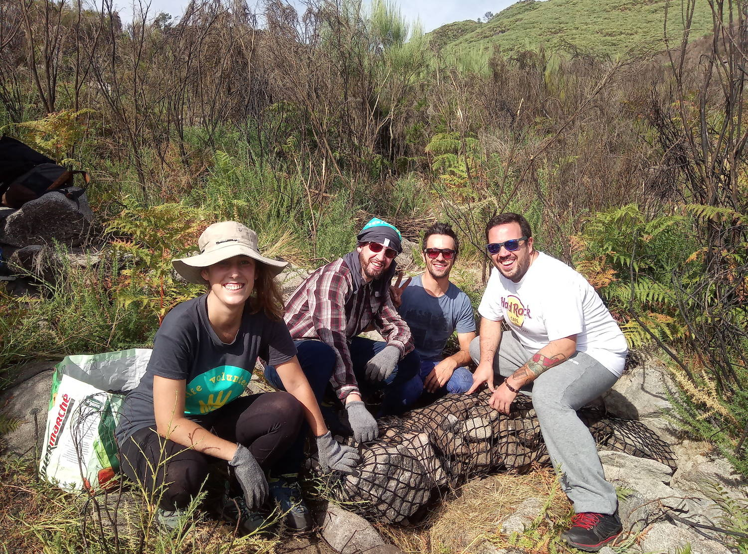A group of volunteers building gabions to help restore waterlines