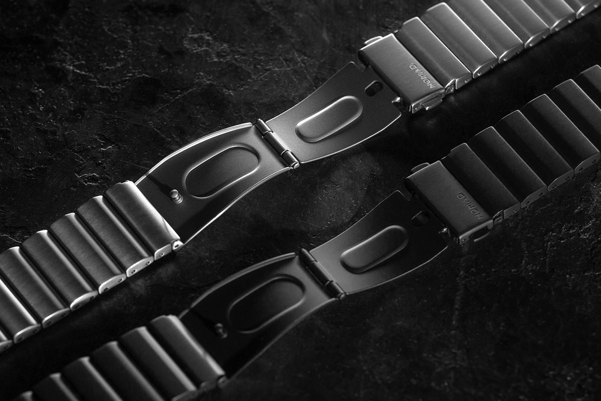silver and black clasp of Titanium Band adjacent to each other