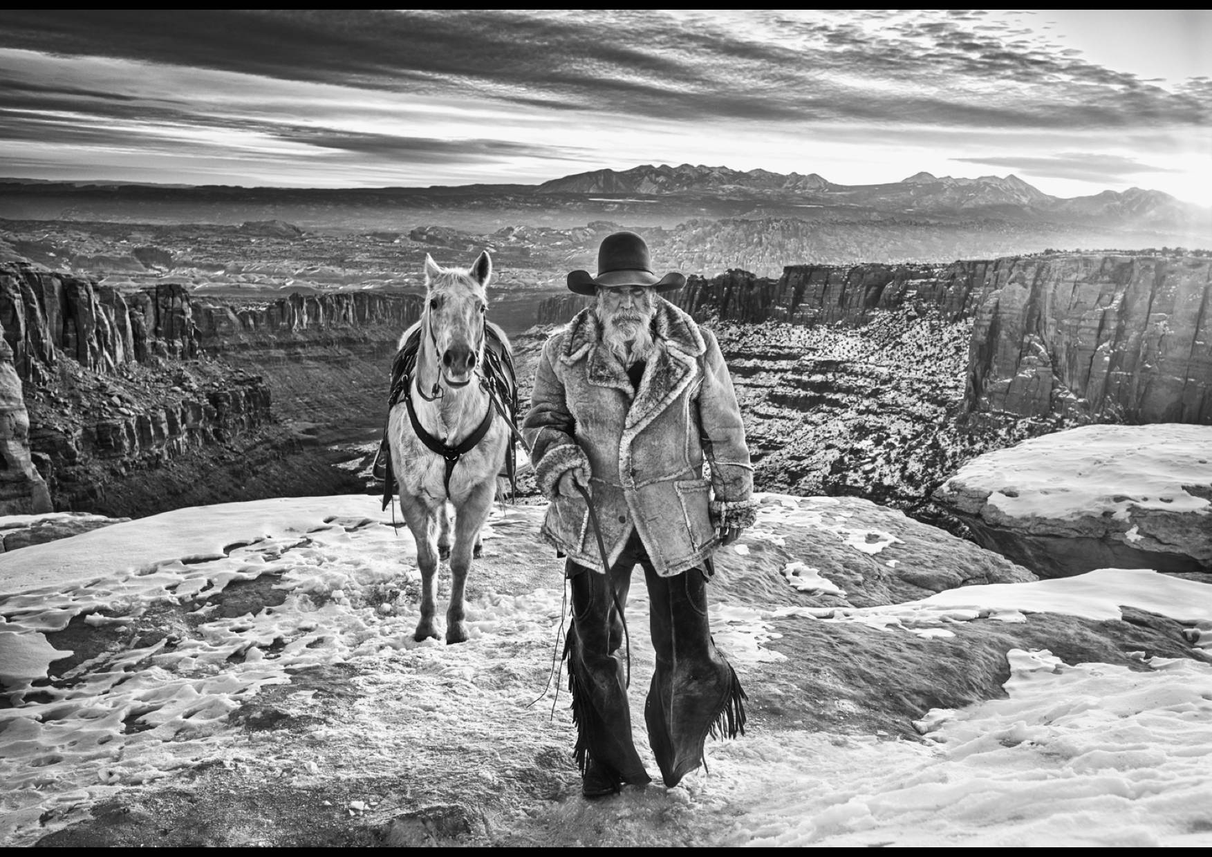 David Yarrow Photography at Sorrel Sky Gallery. The Wild West 2021 Series a cowboy and a horse in Canyonlands.