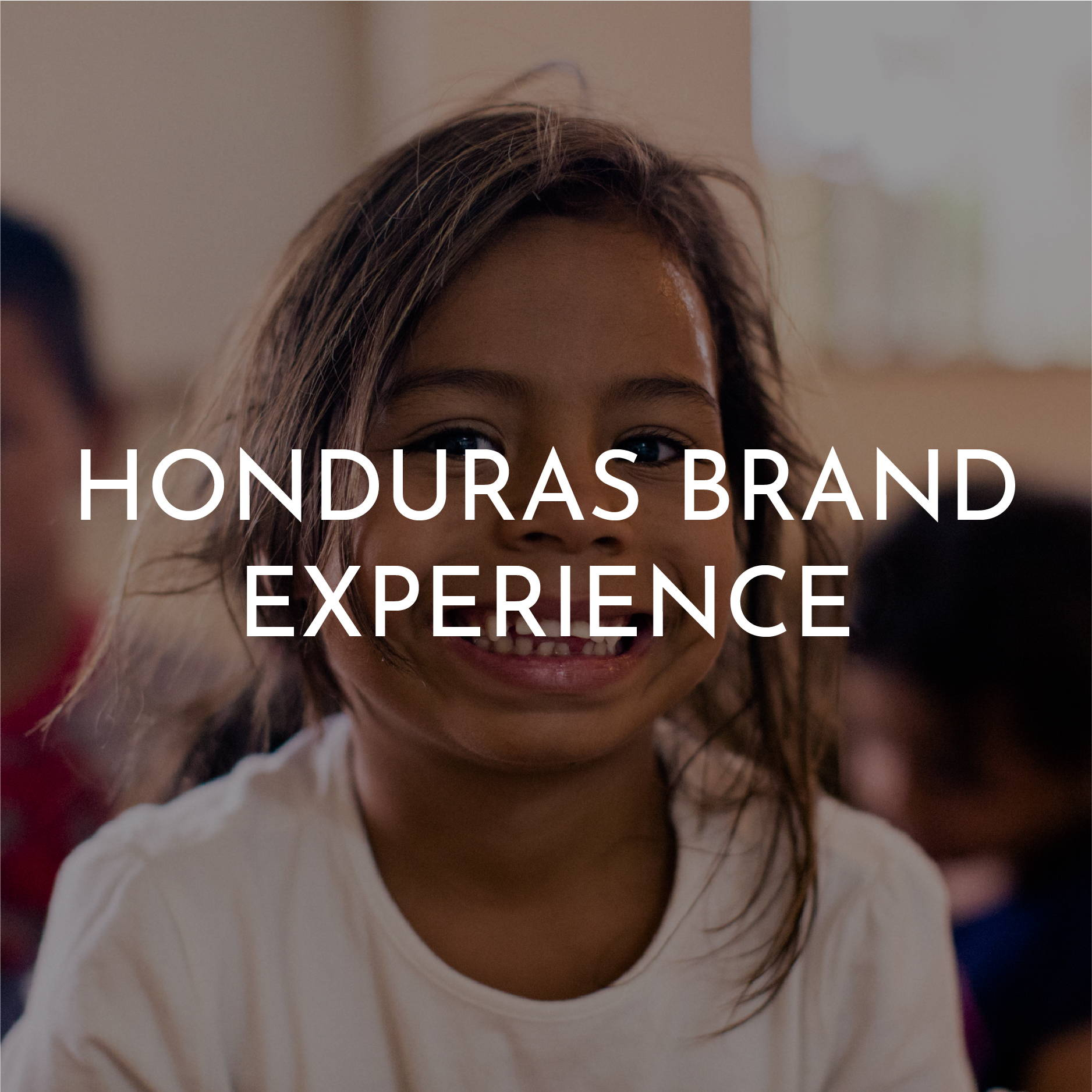 """Honduras Brand Experience"" Is written on top of a smiling Honduran girl wearing a white t-shirt"