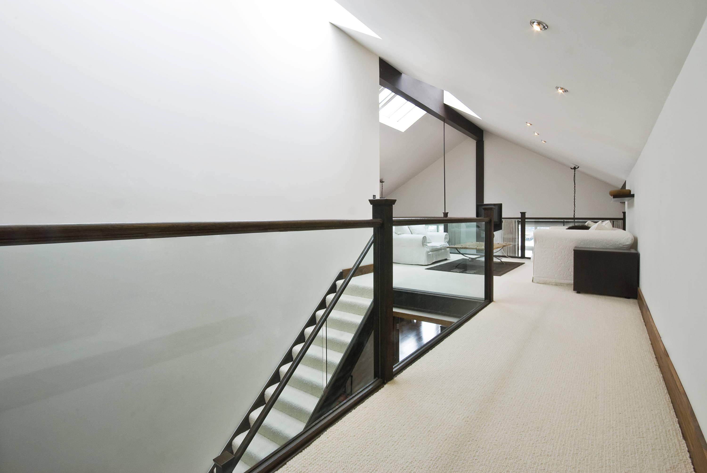 Glass railing with dark bronze handrails
