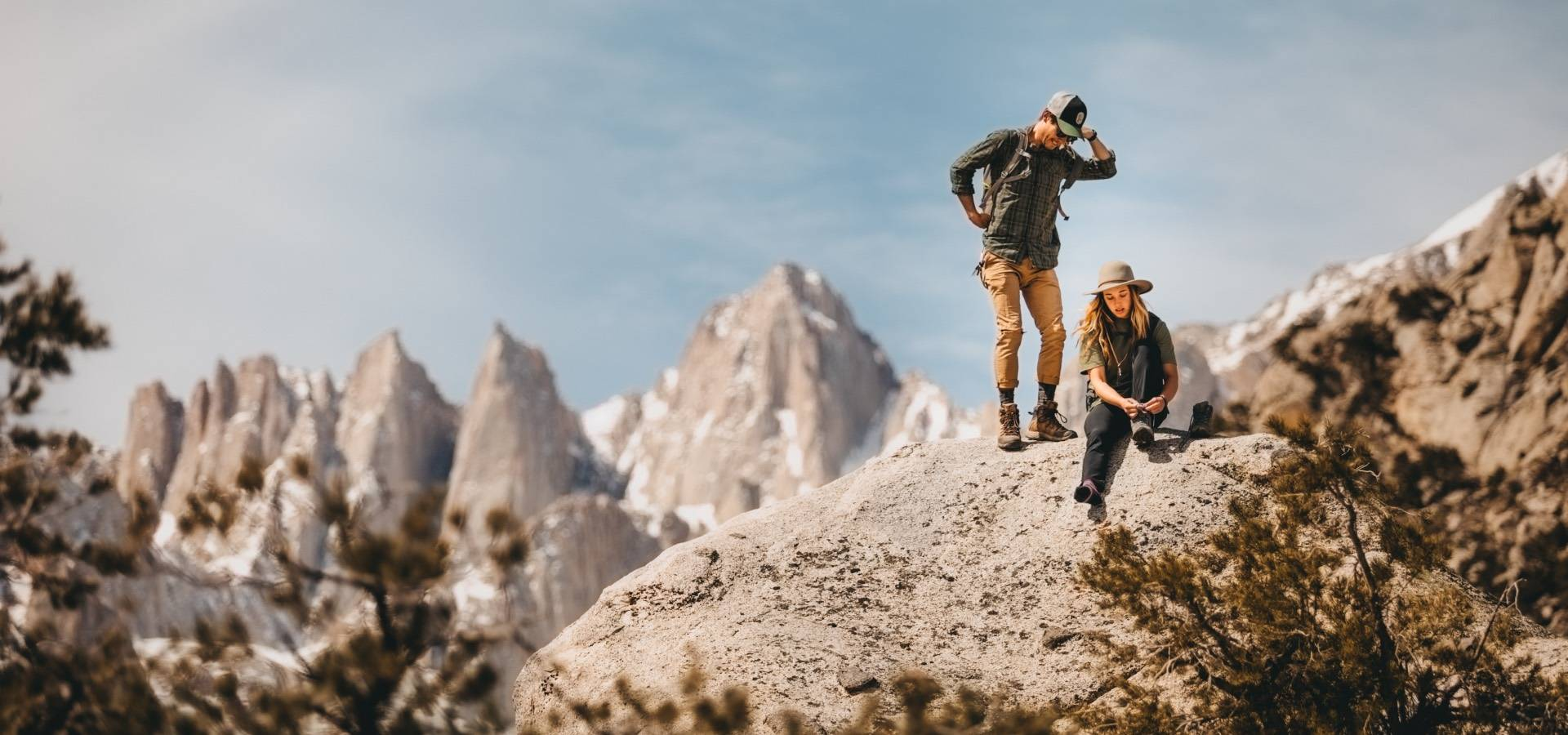 Two hikers on the summit wearing darn tough merino wool socks, the best socks for hiking