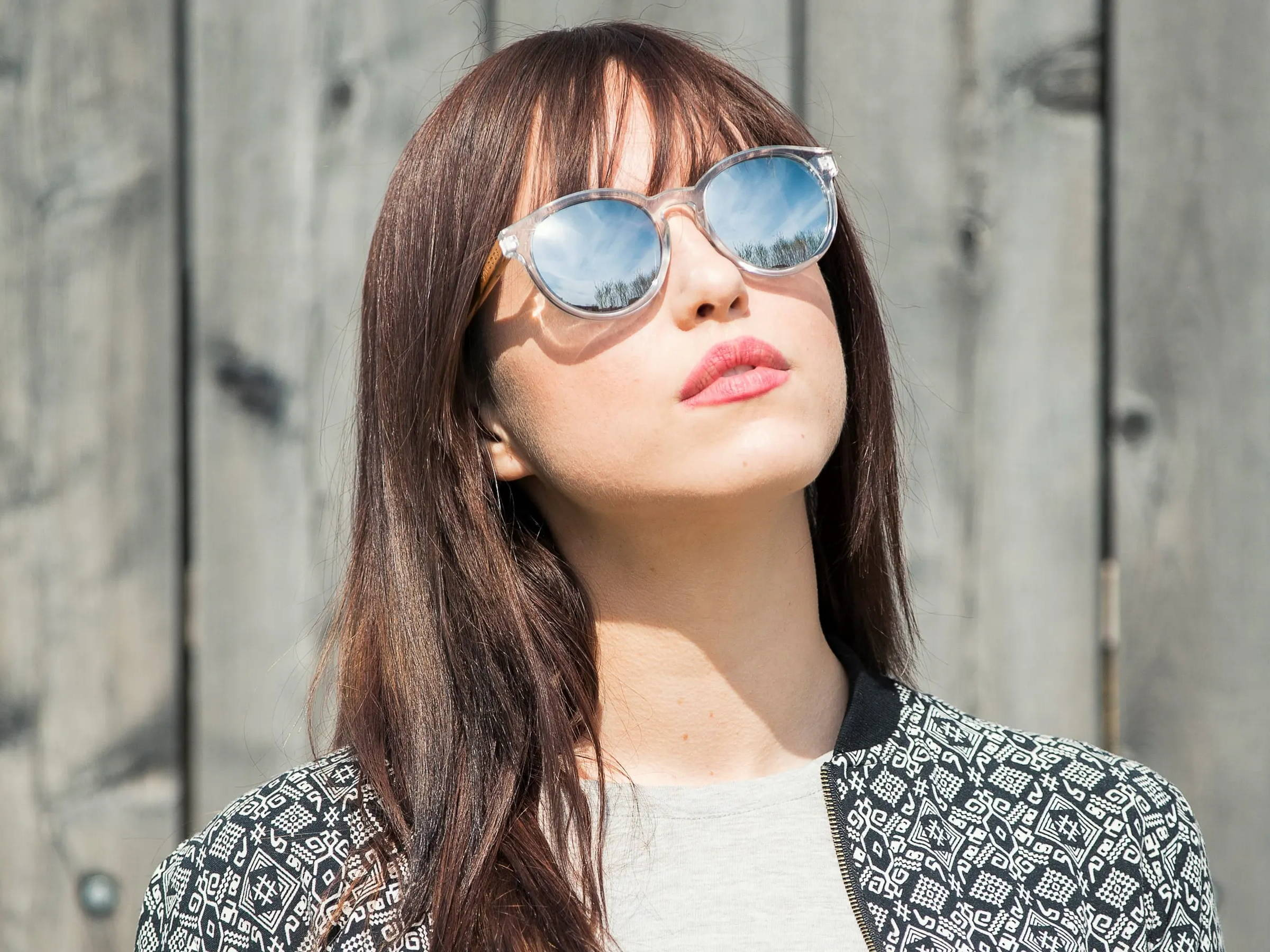 Woman wearing Kraywoods Groove, reflective round Sunglasses made from Zebra wood with polarized mirrored lenses