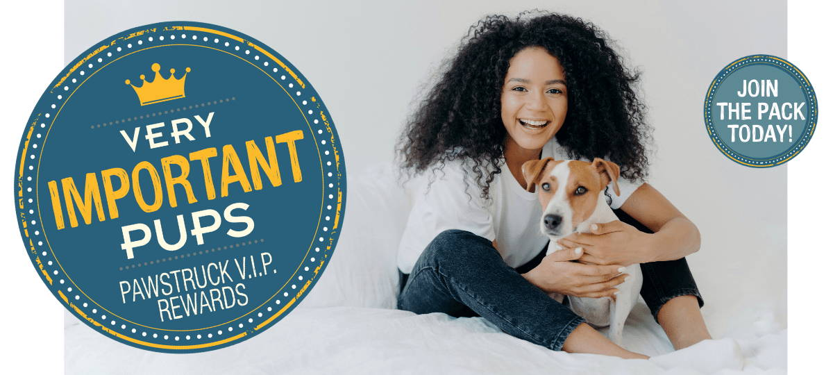 Photo of an African-American woman sitting on a bed holding her dog. Text badge: Very Important Pups Pawstruck VIP Rewards in white and yellow text against a blue background. Blue circle with white text: Join the Pack today!