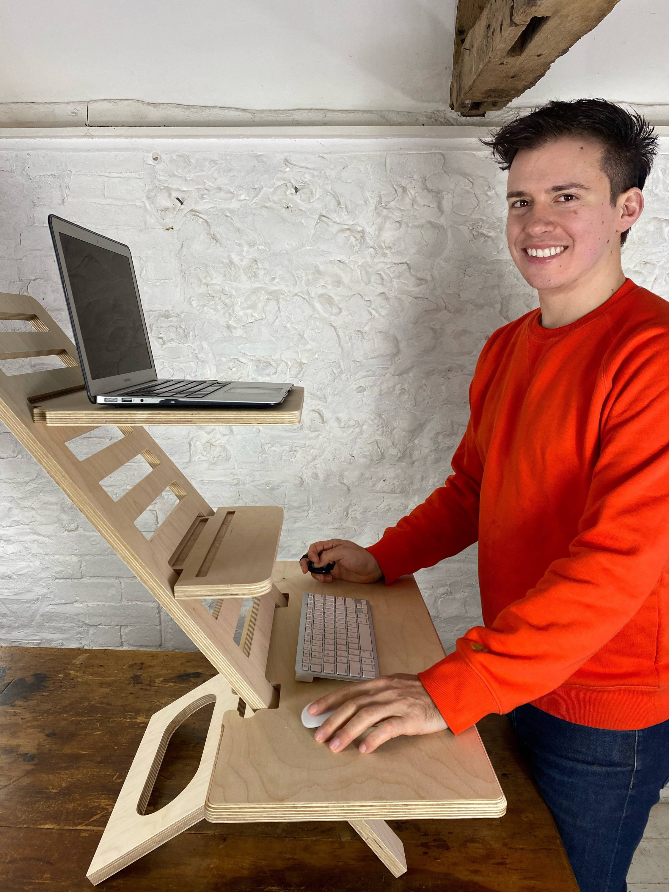 Man smiling with Helves Standing Desk