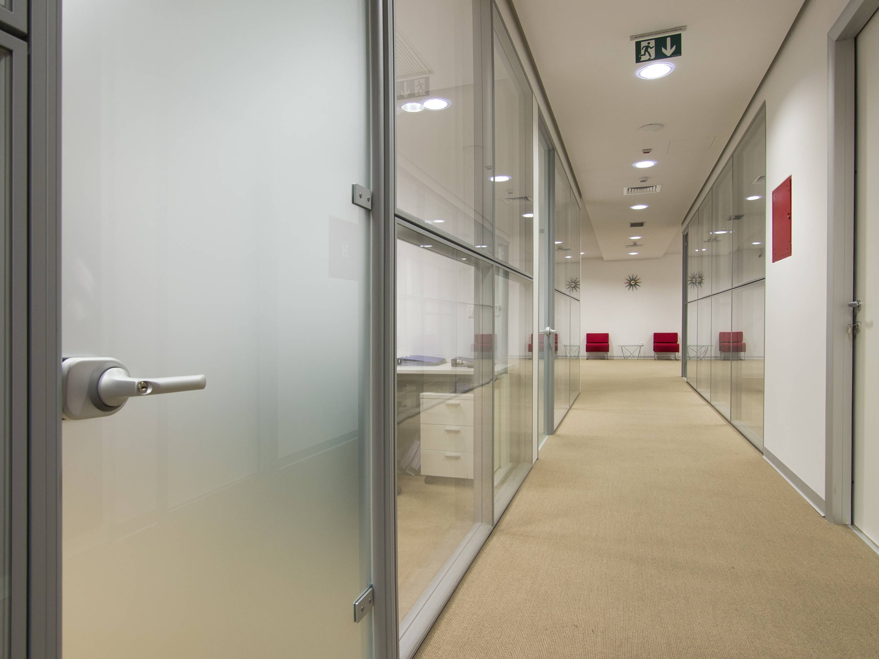 Glass office enclosure with privacy glass