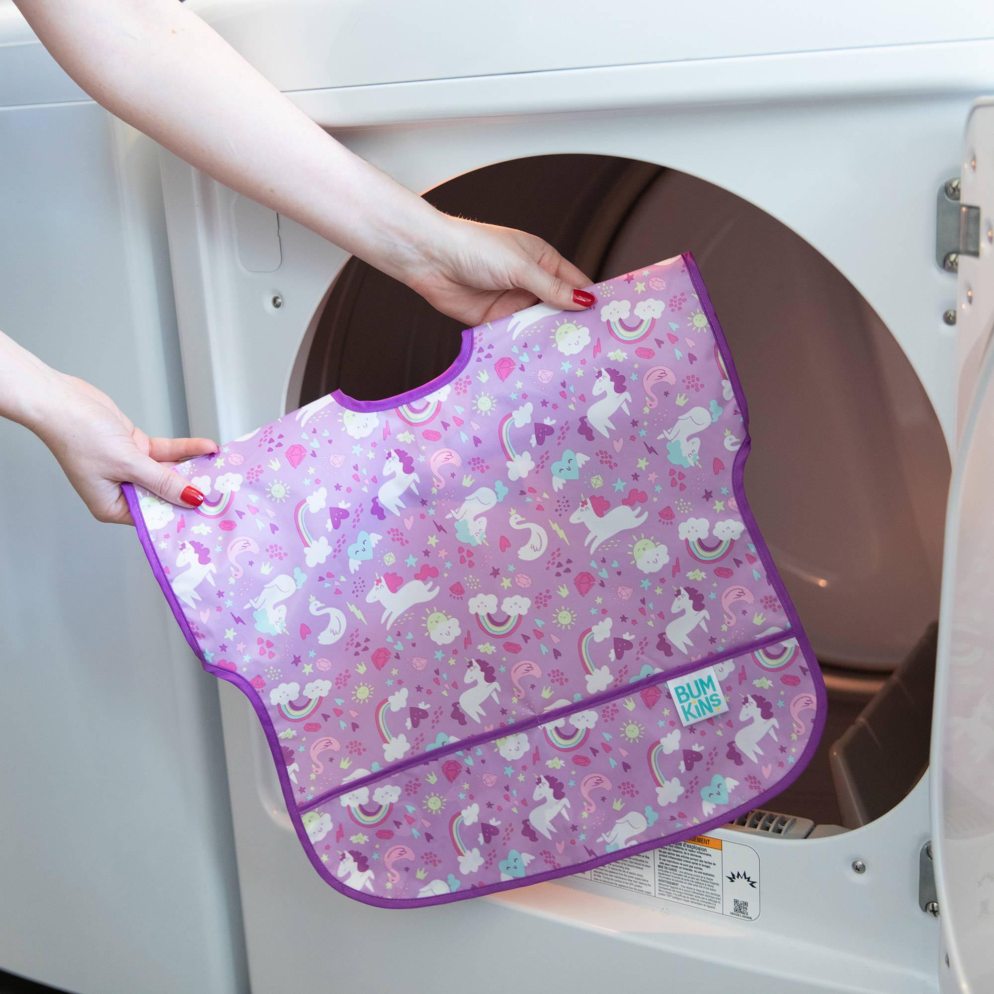 putting unicorn toddler bib in washing machine