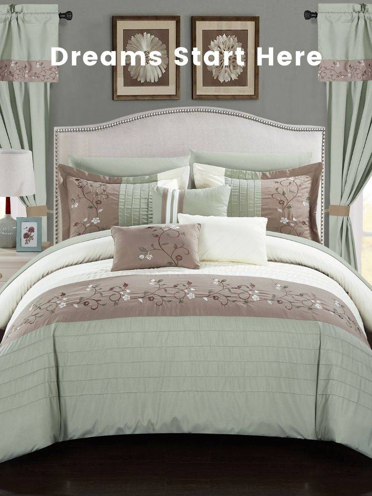 A bed with a green Chic Home Sonita comforter and decorative pillows on top