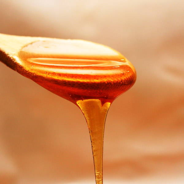 PureBee | Honey Flowing from a Spoon