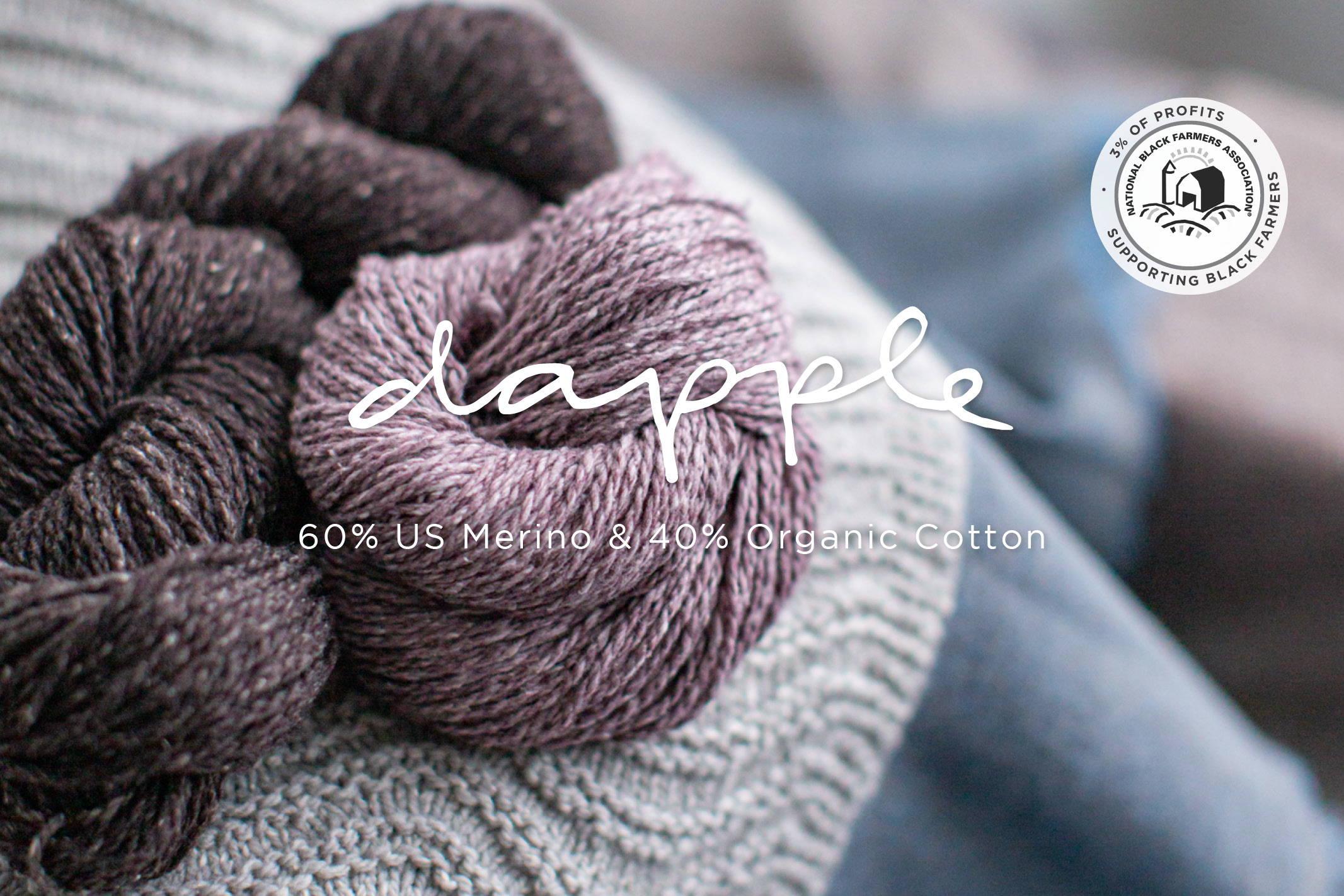 Dapple Yarn balls on table sitting on knitted fabric | 60% US Merino & 40% Organic Cotton