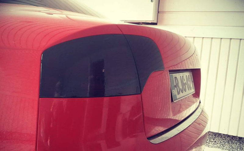 Audi with Charcoal Lamin-x tail light tint film covers