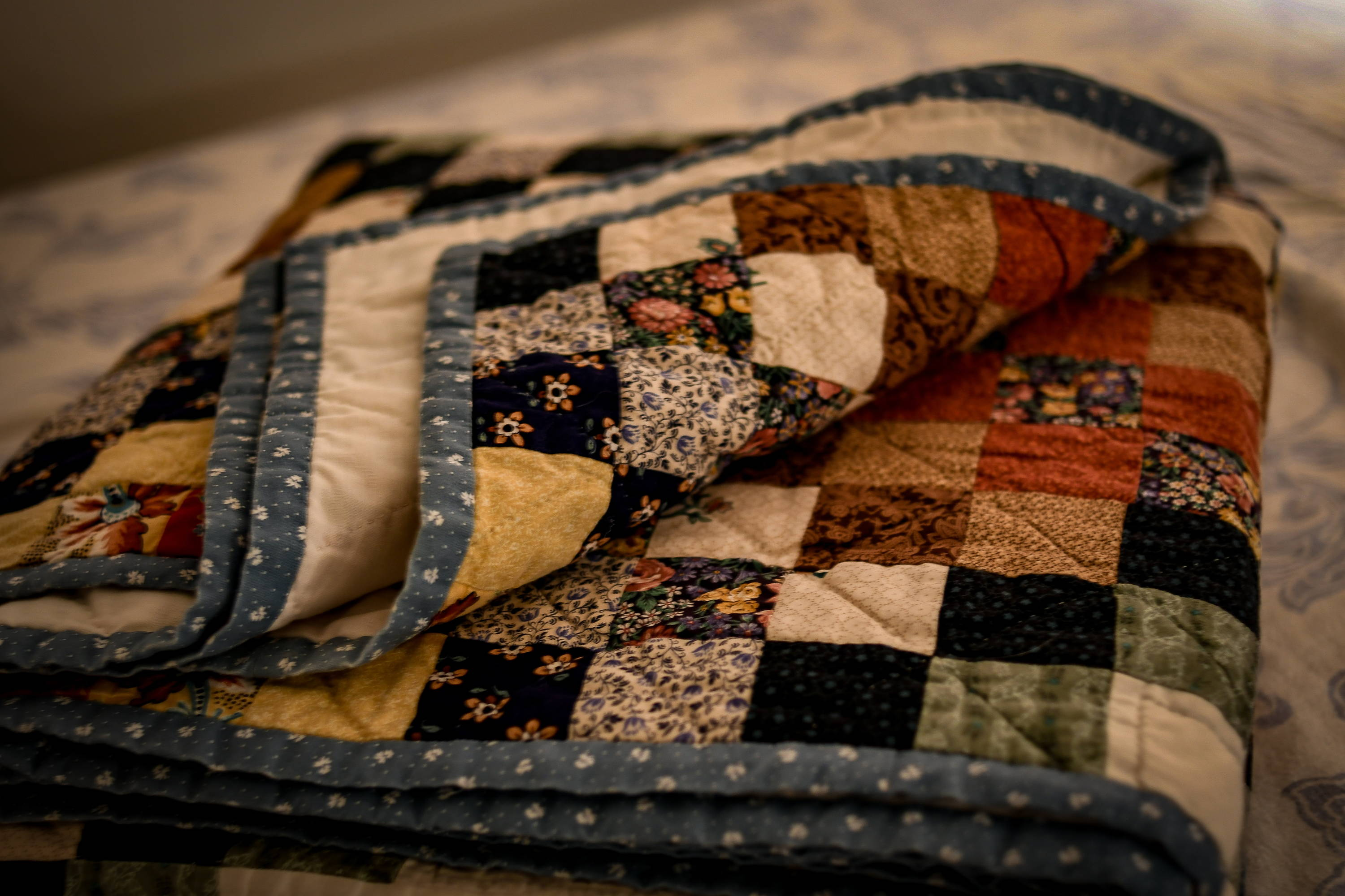 picture of a quilt folded up on a bed