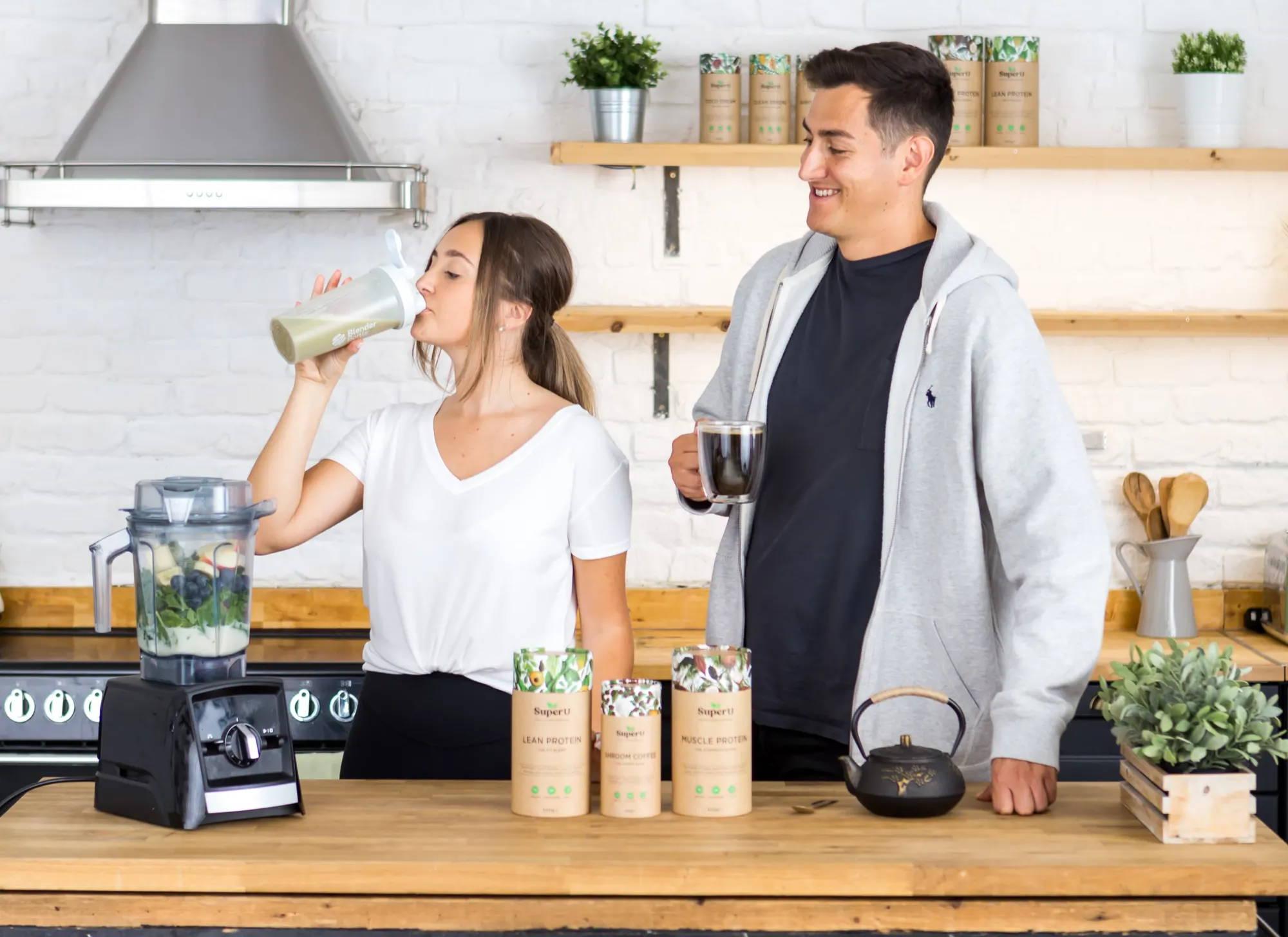 A healthy couple enjoying a breakfast smoothie and mushroom coffee.