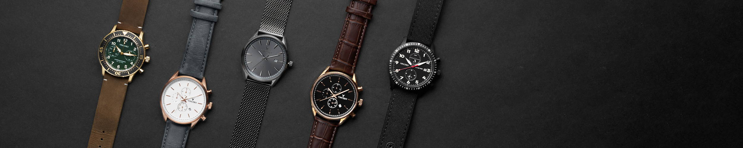 Series of watches laying down on black background