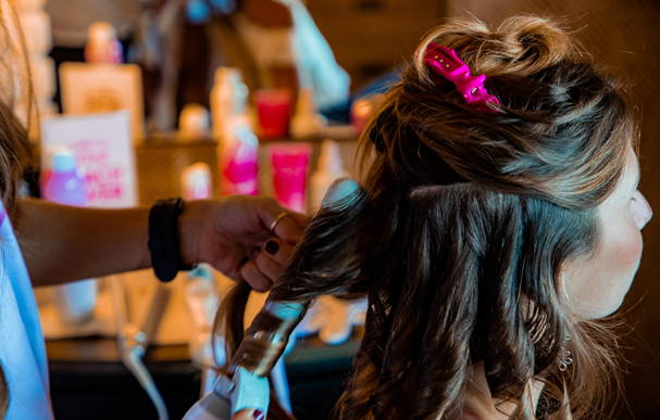 Lily Meola getting Beachwaved at the Styling Suite at the Beachwaver Maui Pro Women's Surf Championships