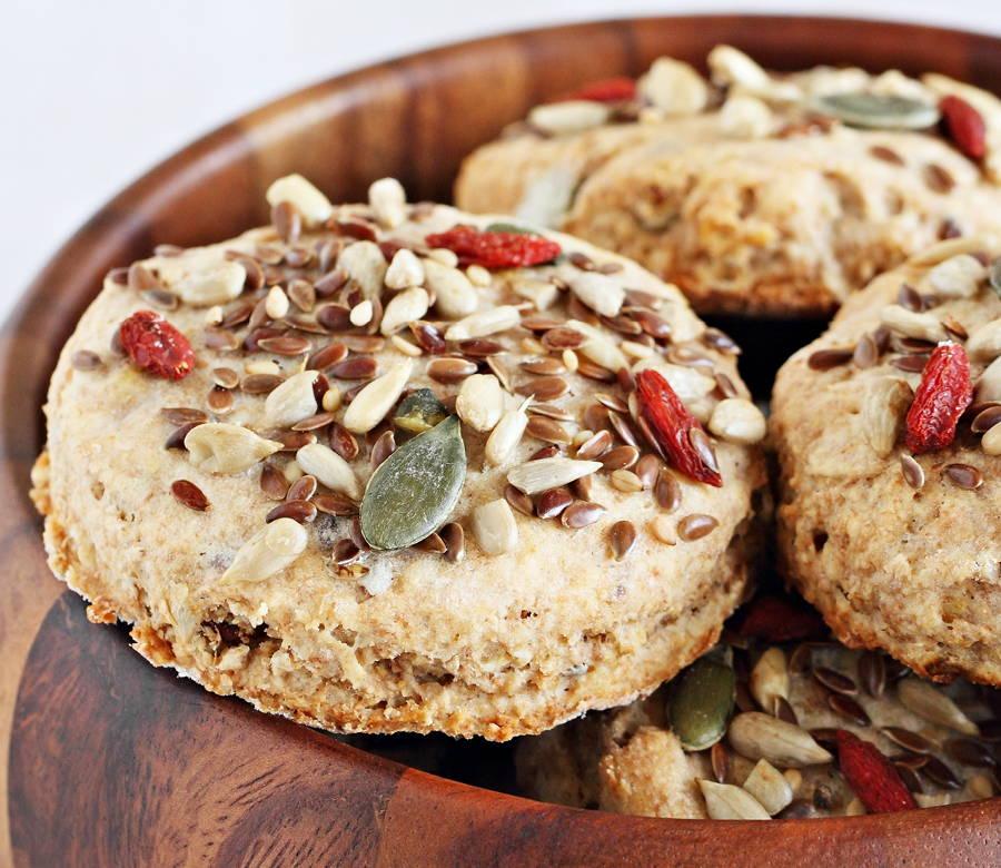 cookies with goji berries and seeds sprinkled on top