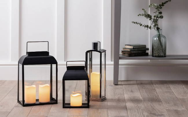 three stylish floor lanterns with led candles placed inside the home