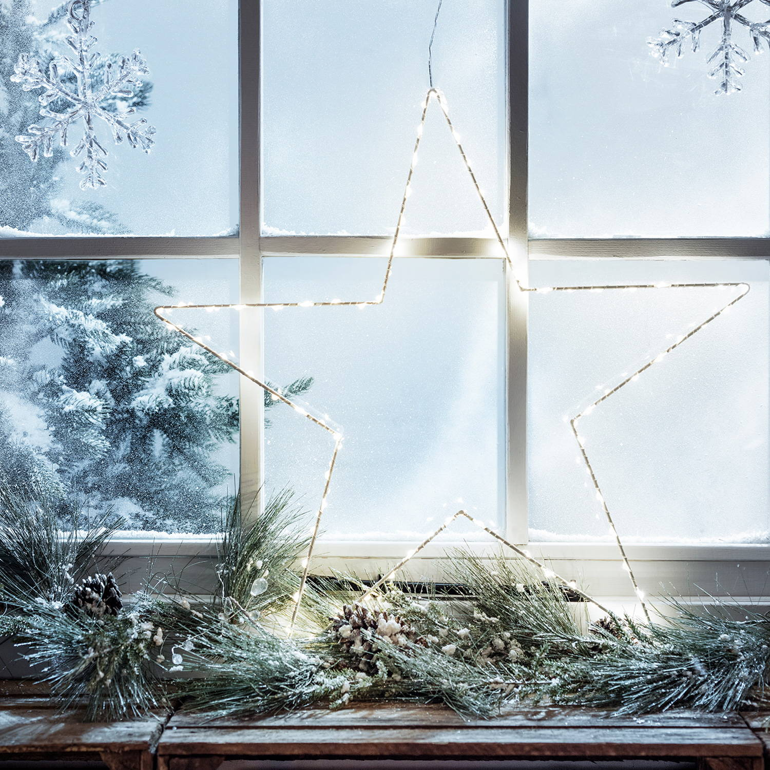 Star Light and Garland on a window ledge