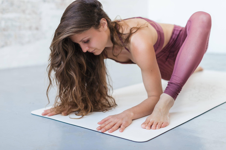 DIYogi white yoga mat in a yoga studio