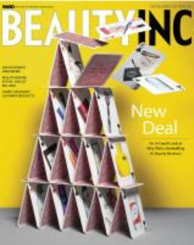 Beauty Inc magazine cover with yellow background and card tower