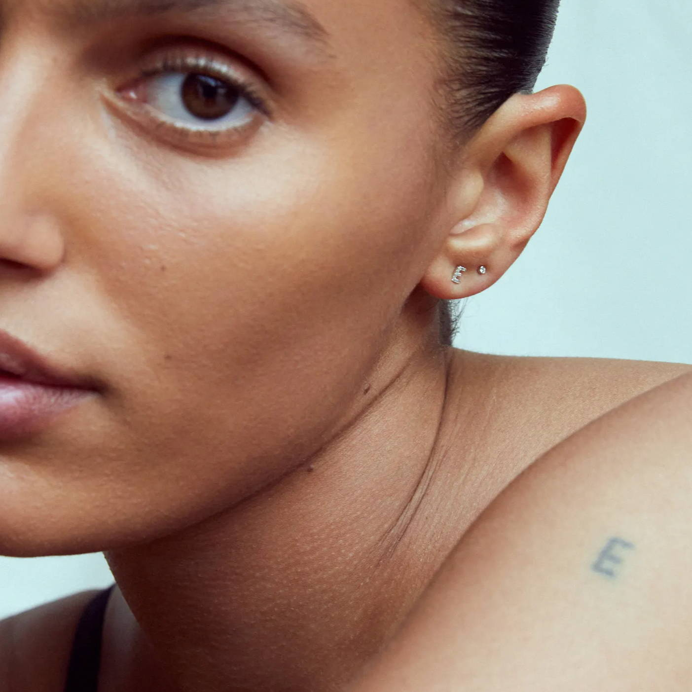 women wearing ennui atelier earrings