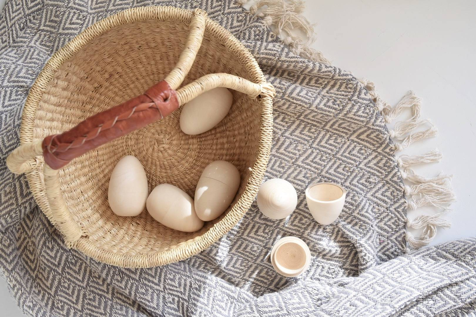 hallow wooden eggs for easter hunt with basket