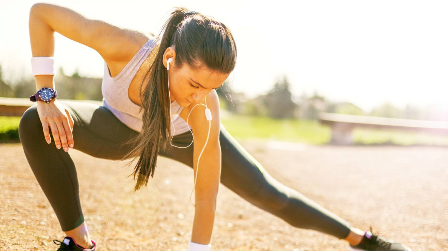 Young sportswoman stretching and preparing to run | The Benefits Of Rice Protein Powder | does rice have protein | Featured