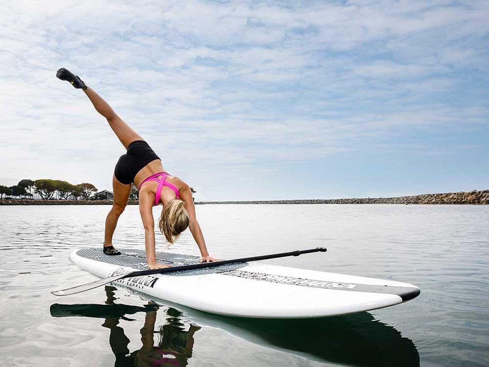 Doing SUP yoga on the Big EZ Hawaiian stand up paddle board