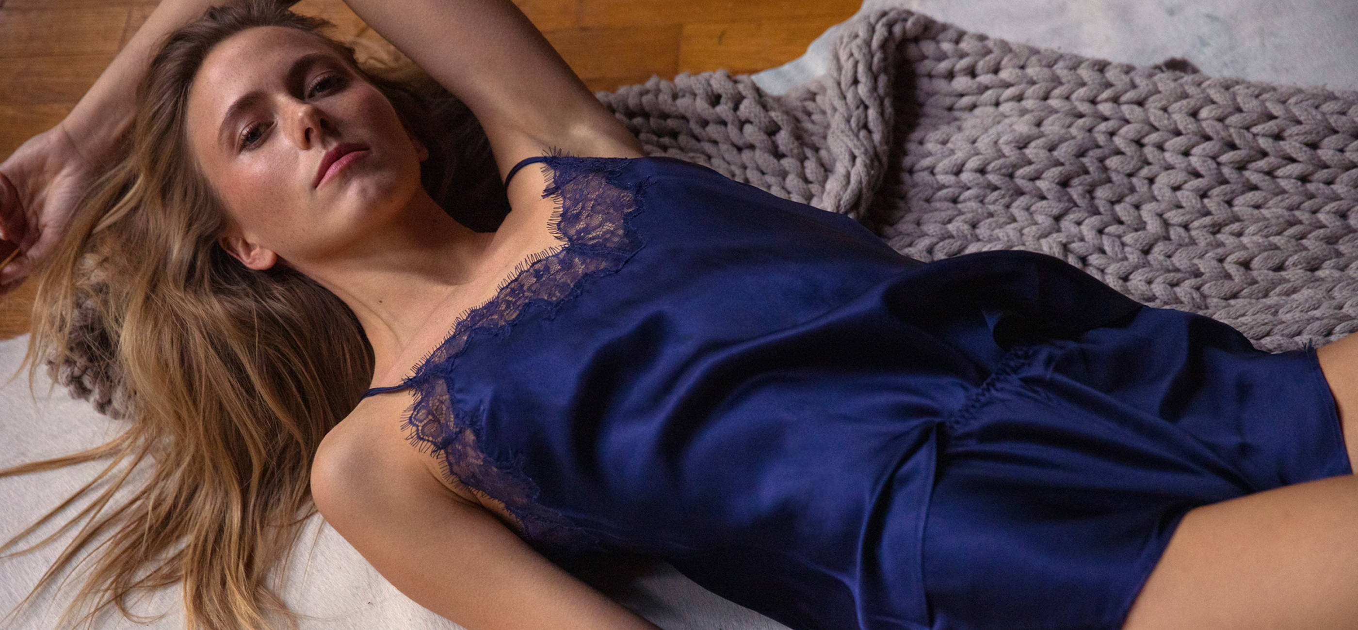 Woman wearing the Journelle Charlotte Silk Camisole and Tap Short in new color midnight.