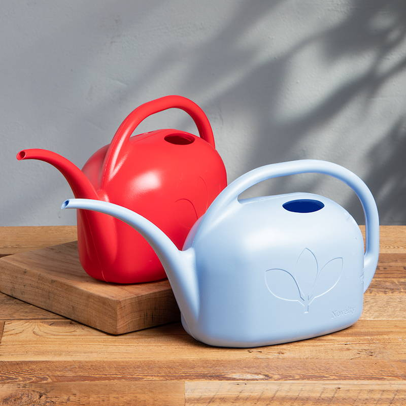 A red and blue 1 gallon watering can