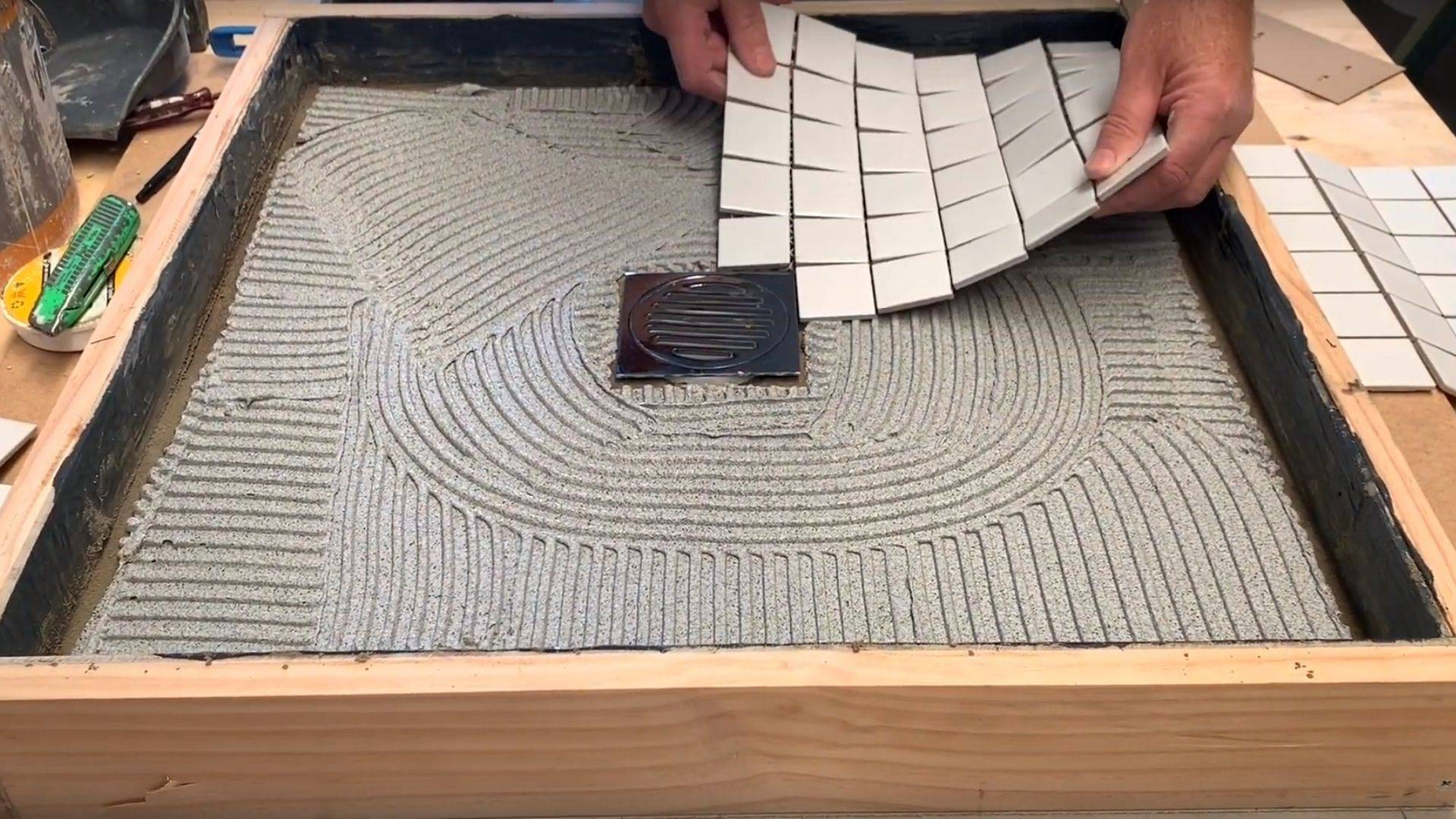 Tiling and grouting to a wondercap puddle flange kit