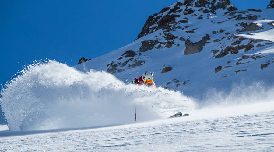 Amie Engerbretson taking turns on her skis in the Andes mountains