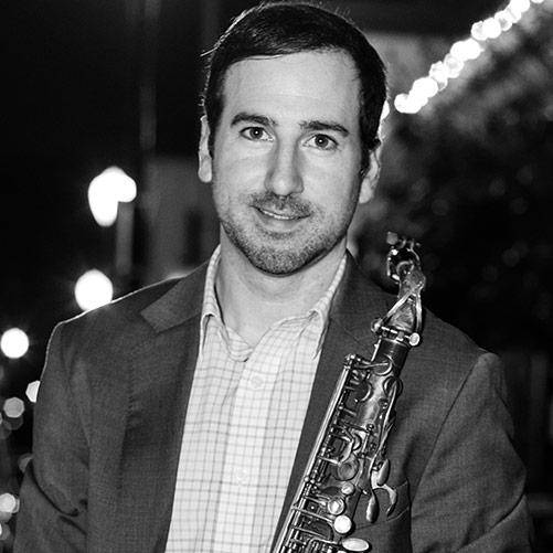 Daniel Ferri holding a Selmer Mark VI alto sax