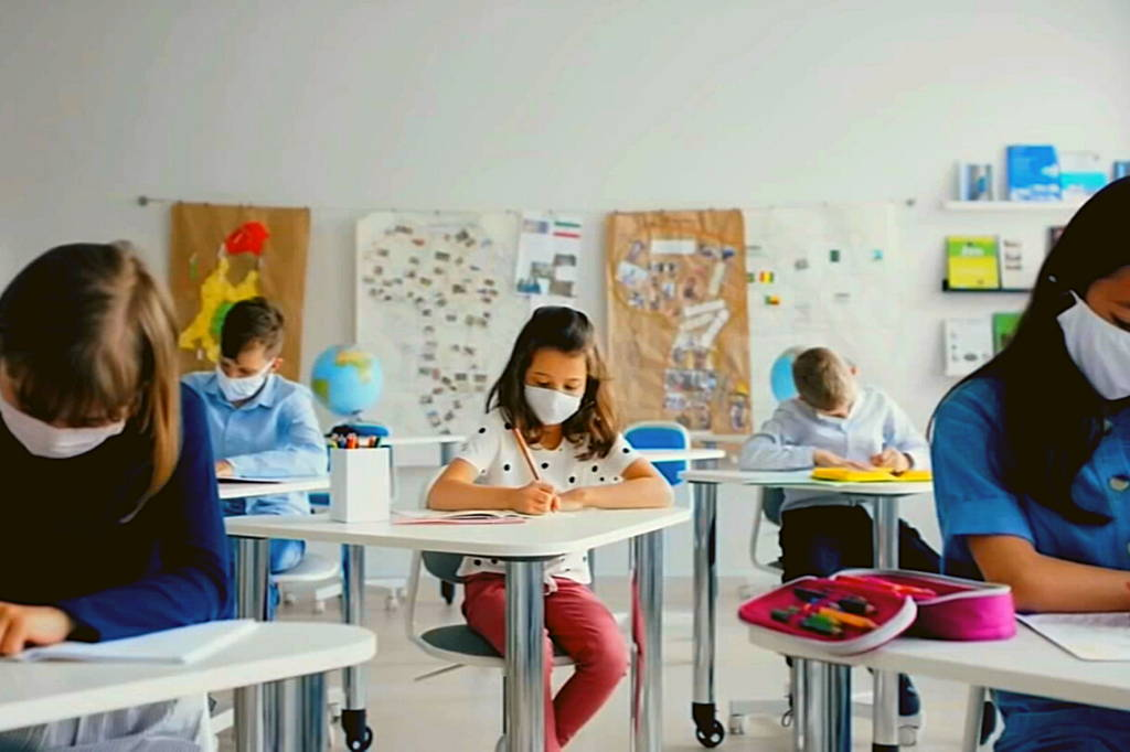 kids learning with masks on at school