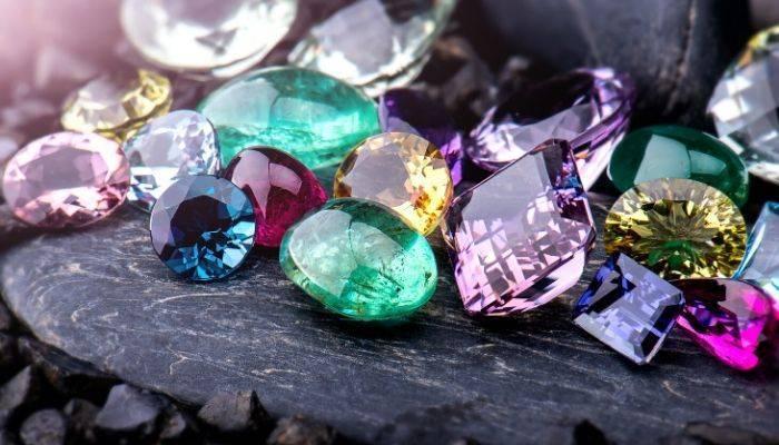 Assorted gemstones on a rock
