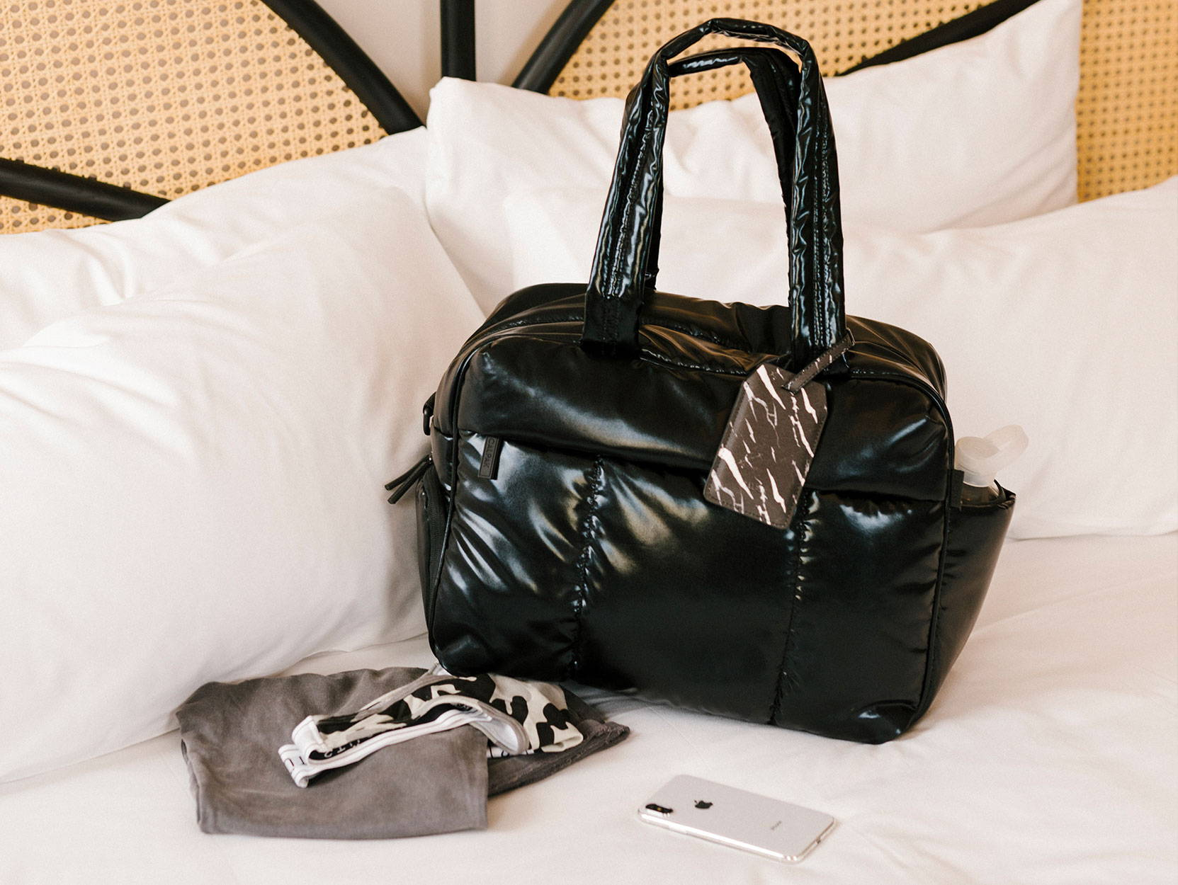 CALPAK Luka Duffel in Black with workout essentials.