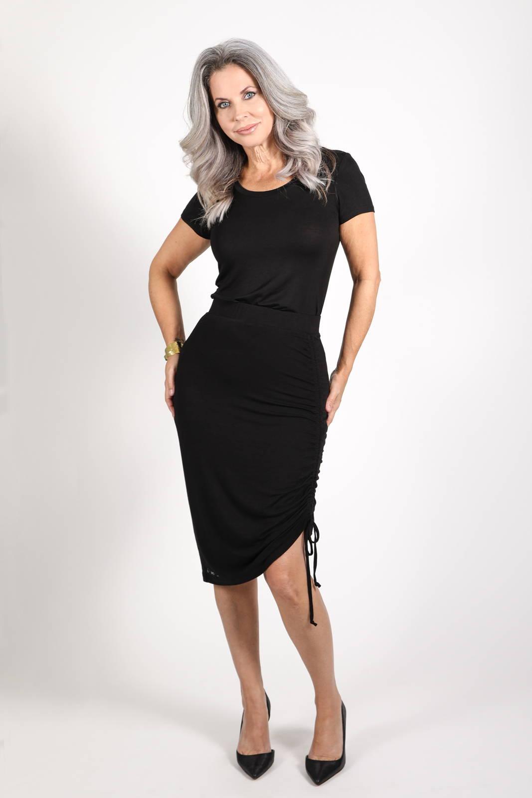 Model wearing the Dawl Tunic in black and Kuma Tie Skirt in Black