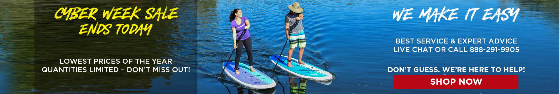 A couple stand up paddle boarding on calm water