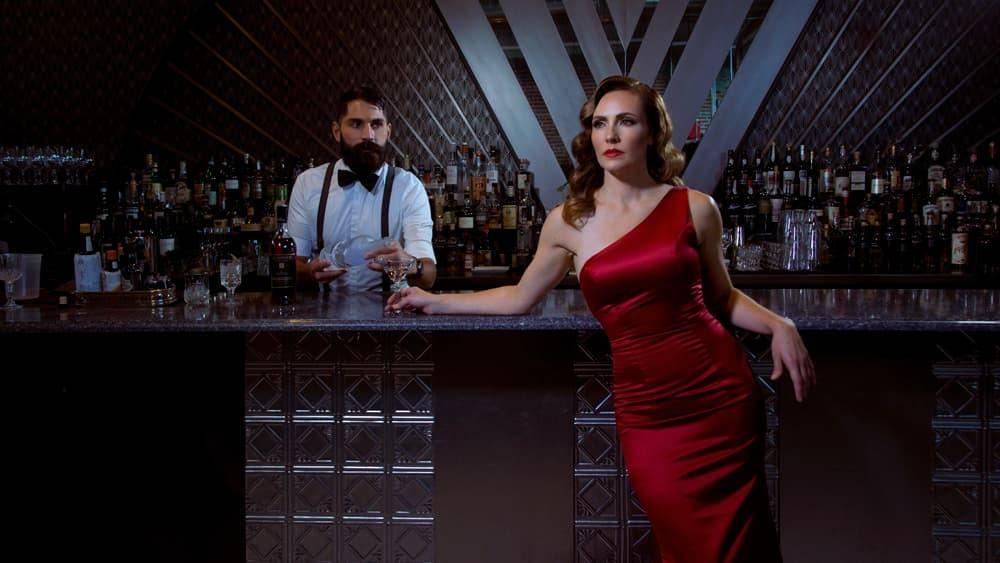 Film noir style portrait in a bar