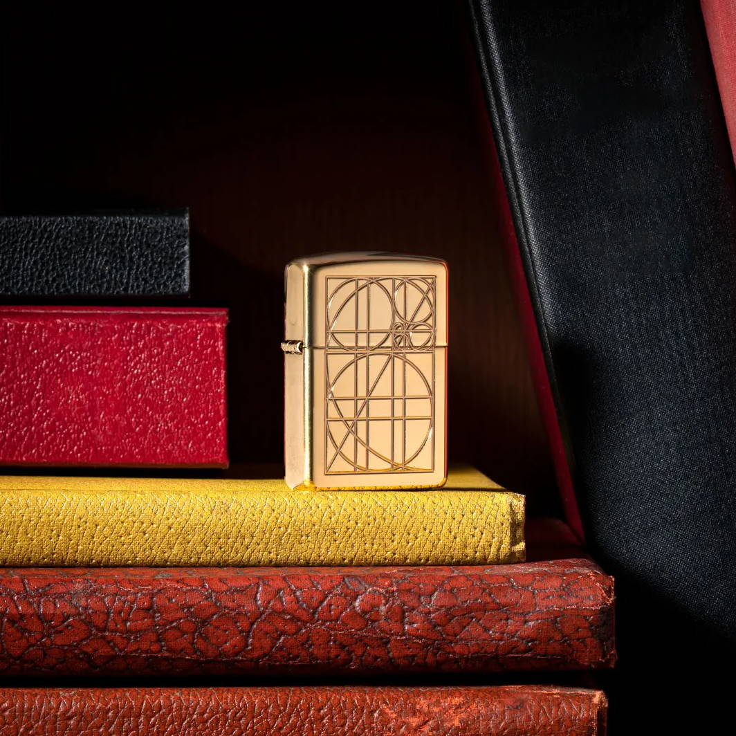 Golden Ratio lighter standing on a group of books