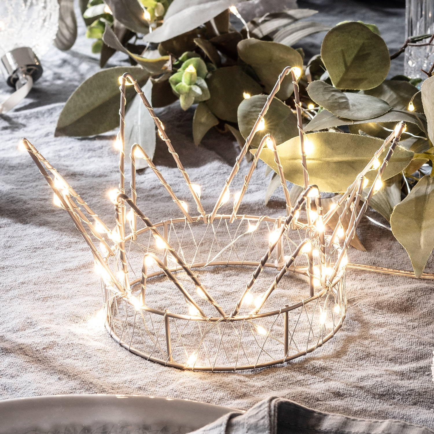 Micro LED crown Christmas decoration placed on top of a table