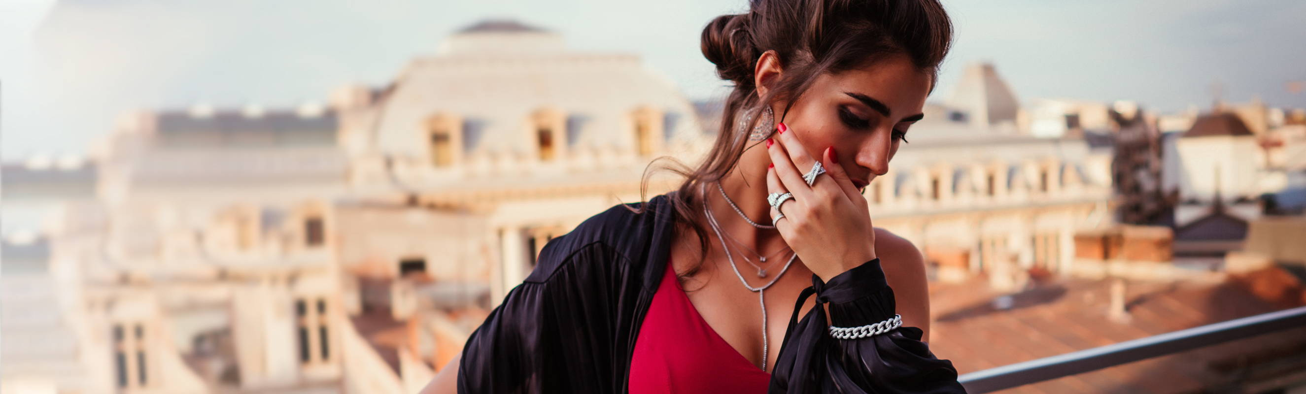 Model on rooftop wearing Ring Concierge jewelry