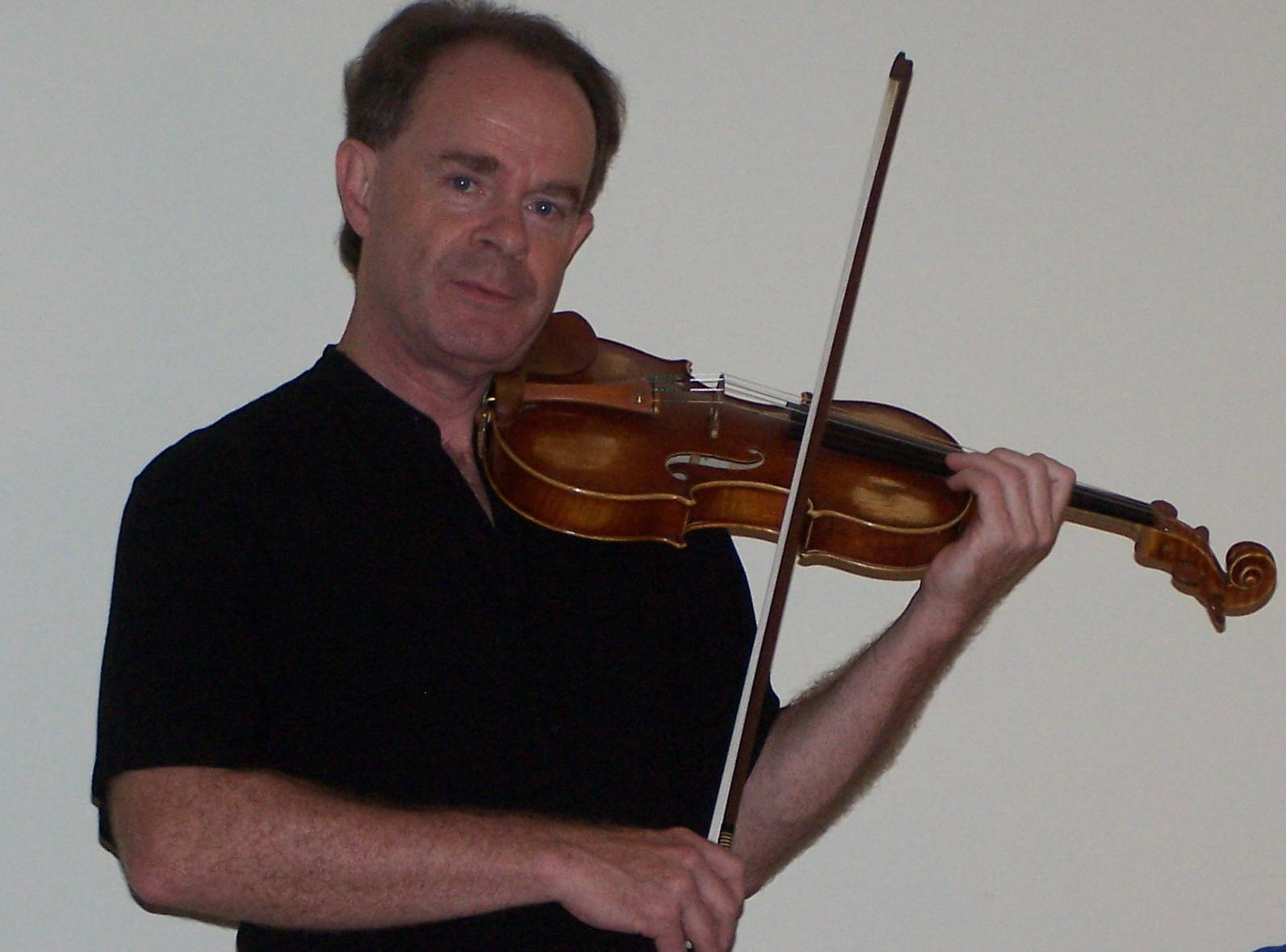 Picture of Pat Ireland holding his violin