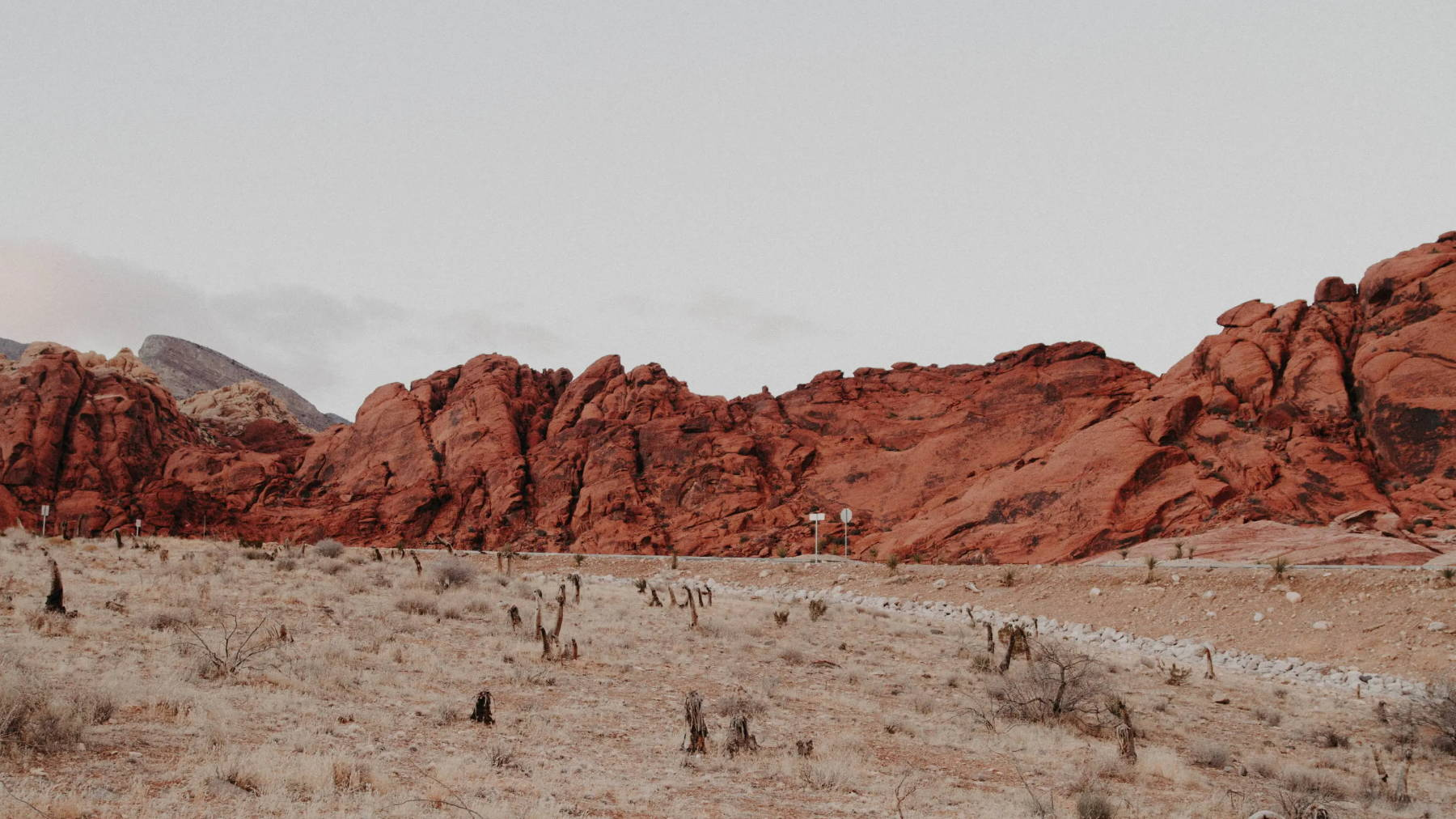 Desert nature with red rock and a hazy overcast sky