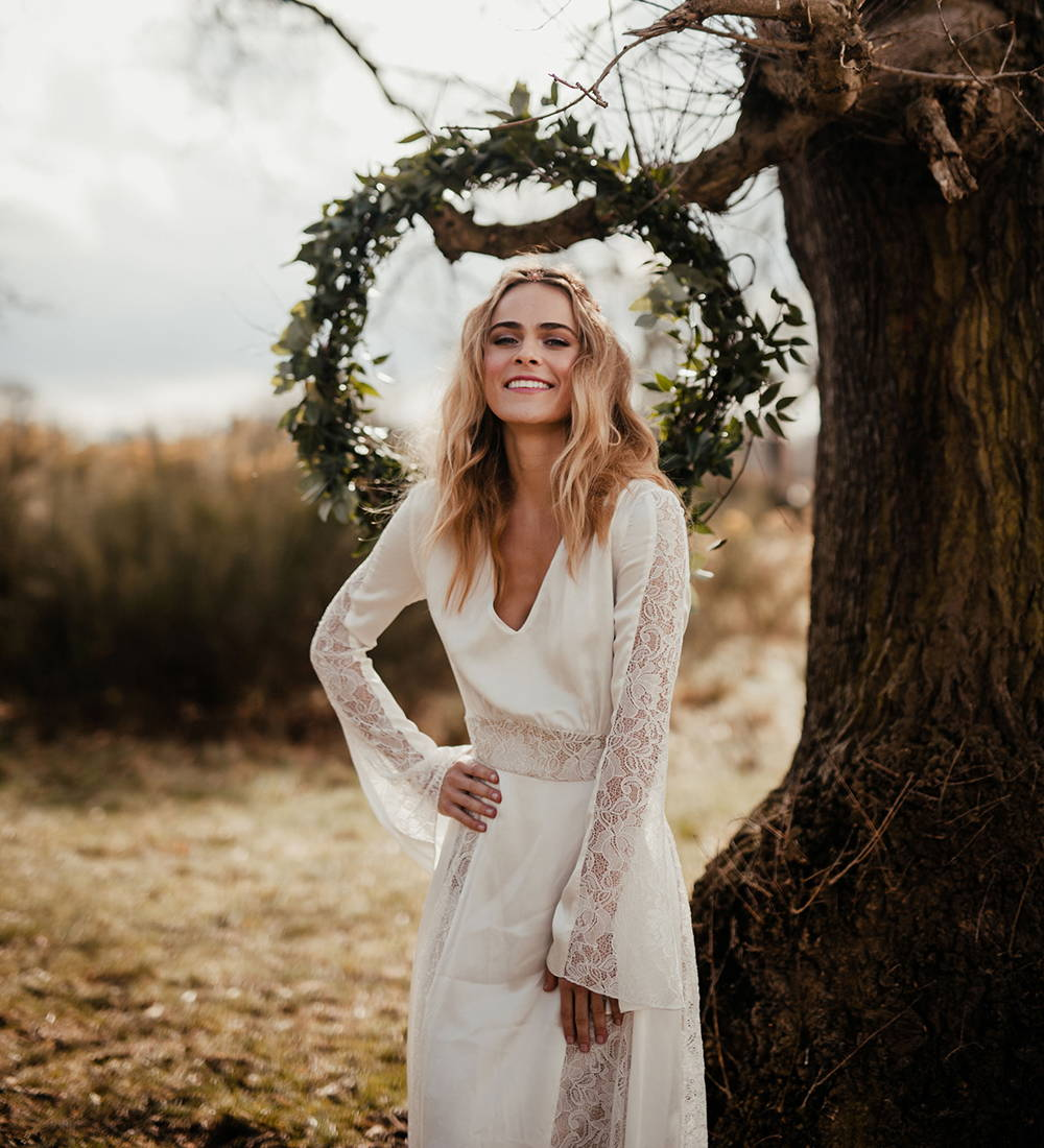 This long sleeve boho wedding dress is perfect for a vintage style wedding. It's one of many wedding dresses from She Wore Flowers.