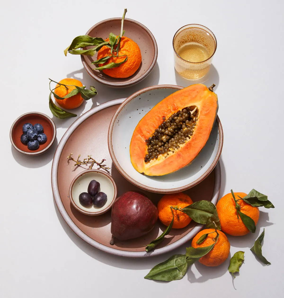 East Fork plates and bowls surrounded by ripened fruit