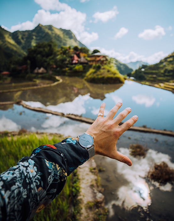 man exploring rice paddies in jungle