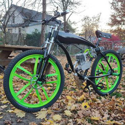 This is a 2-stroke motorized bike complete with saddle, wheel, and performance upgrades.